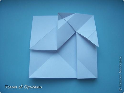 В качестве символа 2011 год делят между собой два животного китайского календаря. Видимо, это не простое совпадение, ведь у них и правда много общего. Оба с кротким нравом и пушистой шубкой.  Этого кролика придумал Стефан О`Хонор, а котика – Джо Накашима.  Подставка в форме четырех сердец – модель Френсиса Оу. Вся композиция сложена из квадратов одинакового размера(2 красных и 2 белых), в данном случае 20х20см. Как сложить из полос бумаги цифры – можете вспомнить в этом МК: https://stranamasterov.ru/node/127038 фото 60