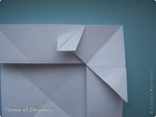 В качестве символа 2011 год делят между собой два животного китайского календаря. Видимо, это не простое совпадение, ведь у них и правда много общего. Оба с кротким нравом и пушистой шубкой.  Этого кролика придумал Стефан О`Хонор, а котика – Джо Накашима.  Подставка в форме четырех сердец – модель Френсиса Оу. Вся композиция сложена из квадратов одинакового размера(2 красных и 2 белых), в данном случае 20х20см. Как сложить из полос бумаги цифры – можете вспомнить в этом МК: http://stranamasterov.ru/node/127038 фото 62