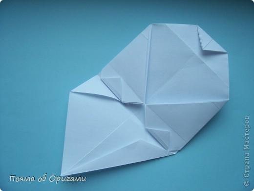 В качестве символа 2011 год делят между собой два животного китайского календаря. Видимо, это не простое совпадение, ведь у них и правда много общего. Оба с кротким нравом и пушистой шубкой.  Этого кролика придумал Стефан О`Хонор, а котика – Джо Накашима.  Подставка в форме четырех сердец – модель Френсиса Оу. Вся композиция сложена из квадратов одинакового размера(2 красных и 2 белых), в данном случае 20х20см. Как сложить из полос бумаги цифры – можете вспомнить в этом МК: https://stranamasterov.ru/node/127038 фото 68
