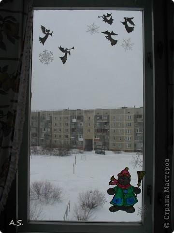 Снеговик на окне фото 3