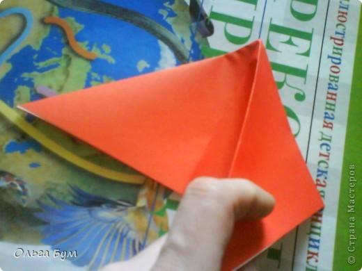 """Это сердце умеет биться! Оно двигается и стучит! Эта забавная динамическая модель оригами настоящая игрушка - мы все подносили друг другу к уху и слушали! Сзади у неё треугольный хвостик, который если сжимать, серединка выгибается вперёд, а """"крылышки"""" назад, при этом слышно """"стук"""". А если около уха держишь, то ещё больше похоже. Мы были в восторге.  фото 8"""