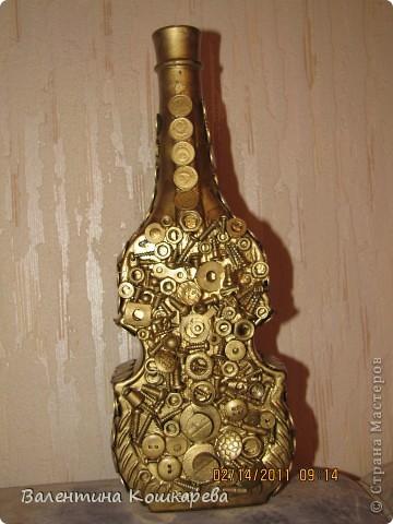 Бутылка с цветами из перьев фото 2