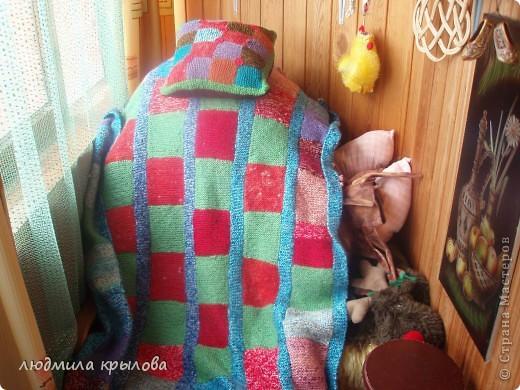 Плед с подушечкой на кресле фото 1