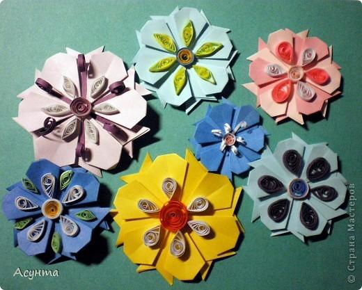 С приходом весны захотелось как-то украсить свой дом, тем более, что до распускания настоящих цветов ещё далековато, хоть я и живу в солнечном Крыму . Поэтому появились вот такие цветочные гирлянды. МК по созданию модульных цветов http://stranamasterov.ru/node/157161?tid=451  Большое спасибо автору! Меня эти простенькие и  милые цветы вдохновили на многочисленные идеи. фото 10