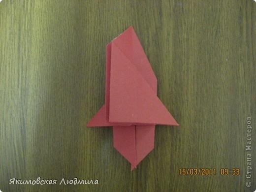 Вот такую ракету в технике оригами можно сделать как элемент композиции на космическую тему. фото 21
