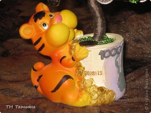 По  Фен шуй для привлечения богатства используется так называемое денежное дерево, которое не просто помогает, а в буквальном смысле притягивает к вам энергию денег. фото 18