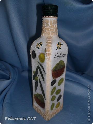 Банка из под детского питания и бутылка оливкогого масла. фото 2
