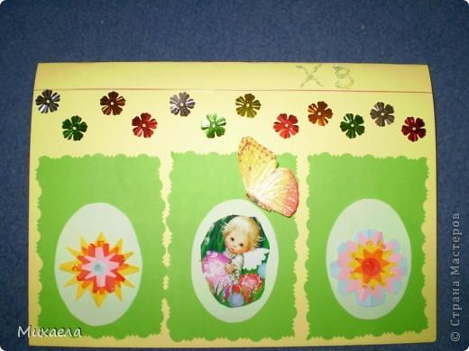 Дочке очень понравилось ваша игра, и сделала  такую открытку, вместе с мамой. Она сделала  цветочки, приклеила на яйчка и клейла ряд цветочков. Моей дочке 5 лет. Она рада результату. фото 1