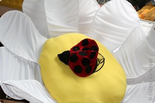 Вот такой костюмчик я сшила на заказ.Вот эти самые крылышки крепились на боди,а на голову одевалась шапочка с рожками. фото 3
