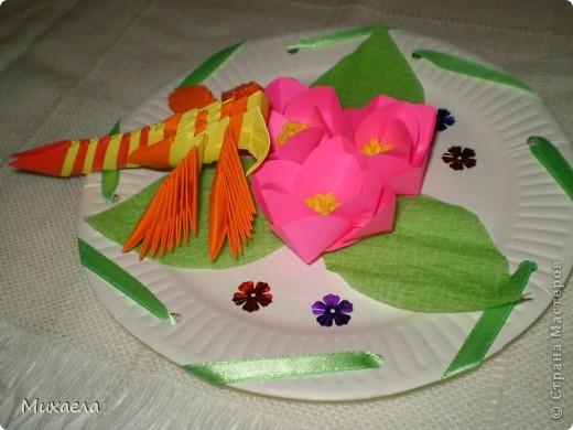 Мое первое модульное оригами, и цветы такого типа тоже в первые сделала, мне они очень понравились, решила попробовать, и вот что получилось... фото 2