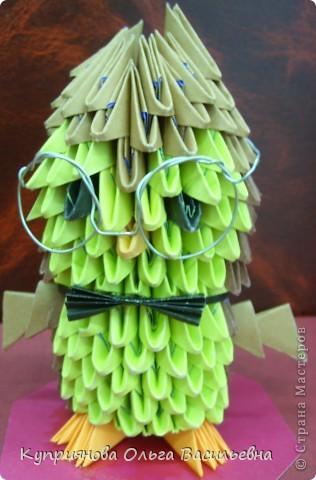 Мы решили в школе провести выставку поделок в стиле Оригами в память о трагических событиях в Японии. Получилось, по-моему, здорово! Бычок, выполненный Женей. фото 3
