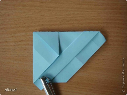 """Готовлюсь к занятиям кружка """"Оригами"""". Тема """"Орнаменты"""". Чтобы заинтересовать, стараюсь сделать образцы. Вот что у меня получилось сегодня. Это орнамент """"Иллюзия"""". Делала по книге Т.Сержантовой """"100 праздничных моделей оригами"""". Выглядит красиво, но уж очень много слоев. Ведь этот орнамент из 20 модулей. фото 21"""