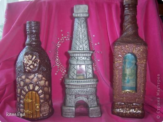 вот такие получились бутылочки.Спасибо Ане Карпусь за МК с крепостью и за змея горыныча http://stranamasterov.ru/node/153839,и Татьяне Сысоевой за винный погреб http://stranamasterov.ru/node/176823,ну а эйфелева башня моя. фото 1