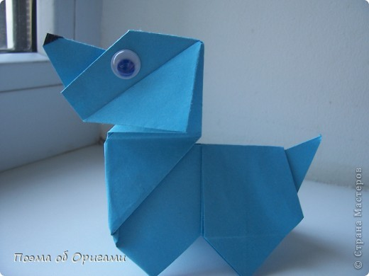 Наш сказочный щенок будет жить в корзинке сложенной в технике оригами, как и он сам.  Идея его создания забавного песика принадлежит Эдвину Кови, а вот корзинку придумал Альдо Патиниьяно. фото 34