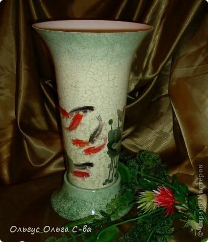 В Китае рыбки - символ денег, благополучия и процветания семьи. При этом даже количество и цвет рыбок имеет значение, можно использовать 1, 4, 6, 9 или кратное. На вазе изображены 9 рыбок арована, известных как Рыба – Дракон. фото 1