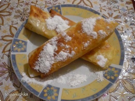 """Сегодня хочу угостить  вас очень быстрым и вкусным десертом. Яблочные рулетики из лаваша от Изюминки (Евгении) с кулинарного форума """"Готовим дома"""". На 1 рулет : полоска лаваша шириной 15 см и длиной в половину лаваша, 1 яблоко , сахар, корица, сливочное масло .   фото 1"""