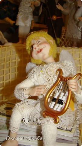 Приглашаю всех на выставку кукол, которая проходит на Тишинке в г. Москве!!!!! А кто не может лично посетить эту интересную  выставку, я хочу предоставить такую возможность, заглянув на неё при помощи моего фотоаппарата..... Приятного просмотра!!! фото 44