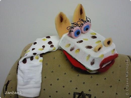 В этом году я продолжила учиться создавать кукол.На первом же занятии у меня получился вот такой почти жираф. Кукла одевается на руку... фото 3