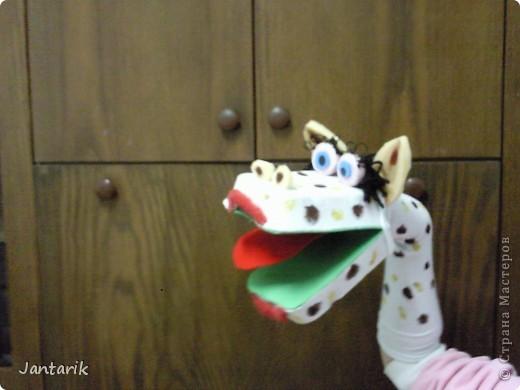 В этом году я продолжила учиться создавать кукол.На первом же занятии у меня получился вот такой почти жираф. Кукла одевается на руку... фото 2