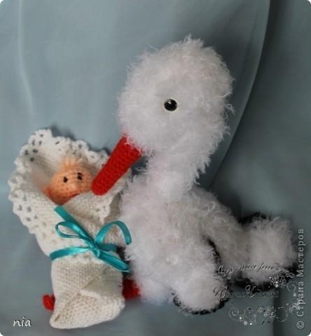 Аист с малышом фото 1