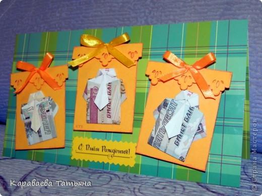 Здесь пошаговая схема в картинках такой рубашки с галстуком http://planetaorigami.ru/2011/02/krasivaya-origami-rubashka-iz-deneg-s-galstukom-prostaya-sxema-video/ фото 3