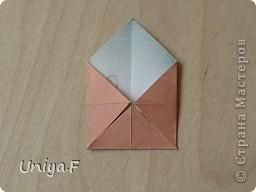 Эту кусудаму я назвала Вафельное солнце.  Она не совсем обычная по строению модуля вставки. Сделать ее из офисной бумаги аккуратно и спокойно у меня не получилось. Бумага здесь нужна тонкая, но хорошо держащая складки. Словом, корейская. И вообще, прежде чем спешно нарезать бумагу, попробуйте сначала черновой модуль. Тогда поймете его особенности, и быть может, желание ее делать пропадет.  30 соед.модулей 2,8*5,6 (1:2) и 30 вставок 4*4. Итог 6,5 см. Сборка без клея. фото 4