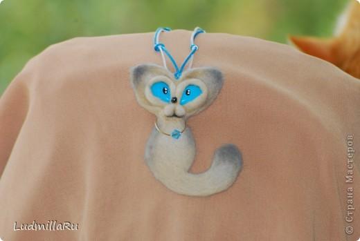 голубоглазый талисманчик фото 1