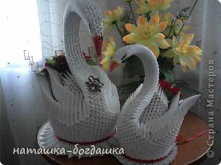 когда то меня попросили сделать на свадьбу пару лебедей,вот что получилось.