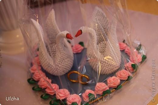Пара лебедей из модулей на свадьбу.