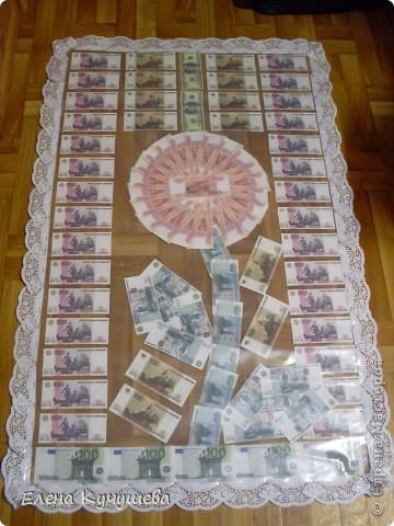 На просторах инета  увидела одеяло  из денег  для  молодожёнов, и родилась идея сделать подарочный ковёр ко дню рождения нашей заведующей. фото 1