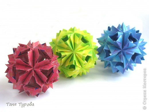 Здравствуйте, дорогие мои!  Сегодня у меня разгадалки кусудам М. Синайской. Фото автора  http://www.flickr.com/photos/goorigami/5485038423/  Все 3 из полосок 7,5 напополам Итоговый размер - 7,5 - 8 см собраны без клея фото 9