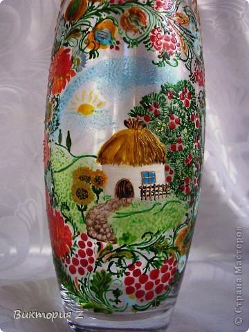 Вот такую вазу я сделала в стиле петриковской росписи витражными красками. Рисунок взят с интернета. Это был, своего рода, эксперимент, так как роспись была сделана сначала красками, а уже потом некоторые елементы контуром.  фото 4