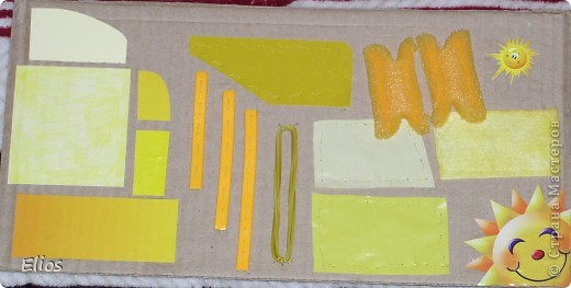 """Вот такую развавашку я сделала для одного малыша.  Использованы материалы: картон, бумага, цветной полиэтилен, пластик, шлейф, вырезанные картинки, нитки, спицы, крючок, резинки канцелярские, упаковка от кофе, губки для мытья посуды, тканевые салфетки крашеные акварелью, ткань и прочая разноцветность. Конечно, это скорее подходит к разделу """"Аппликация"""", чем к """"Вязанию"""", но саму идею я подсмотрела именно из навязанных разноцветных квадратиков, пришитых к картонным листам. Я же в своей работе хотела не только цвет малышу показать, но и оттенки этих цветов, а так же чтоб он пальчиками потрагал разную материальность: гладкую-шершавую, твёрдое-мягкое.  Ребёнку подарок очень понравился - сразу попытался оторвать резинки)) фото 1"""