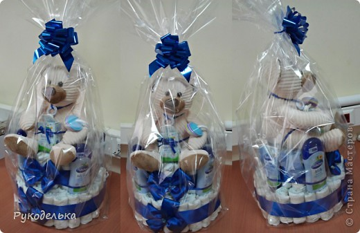 У нашего начальника 2 июля родился сынуля. Мы с коллегой решили сделать подарок в виде тортика из памперсов. Вот что у нас получилось: фото 2