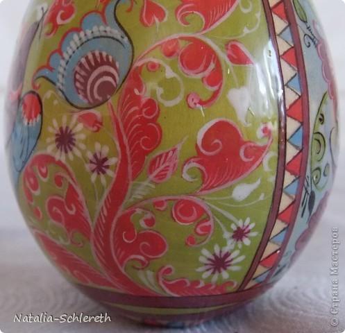 Яйцо выполнено в Борецкой росписи. Яйцо двустороннее-на каждой из половинок свое,но связанное общим замыслом,изображение. фото 7