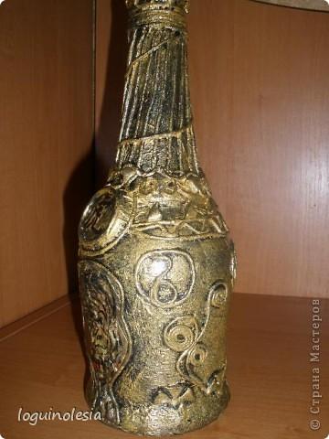 Вот такая получилась у меня бутылочка по технике Пейп-арт от Татьяны Сорокиной. Сделана мужу в подарочек, конечно с 5 зв. коньячком.Эроглиф японский означает тигр . Конечно же использовала и холодный фарфор и бумажку. фото 2