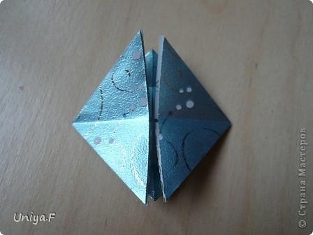Здравствуйте, друзья!  Сегодня выкладываю туториал на кусудаму, которую подарила Олесе на день рождения. Олеся вместе с мамой придумали ей интересное и очень подходящее название: Магический кристалл.  Кусудама легко собирается из 24 модулей, из 12 модулей получается крошечной, подойдет на обвес. А из 30 модулей у меня собрать не получилось. Это  реально, но трудно, требует терпения и выдержки, чтобы сдержать эмоции и не сорваться на клей. К тому же в этом варианте она выглядит наиболее симпатично.    Name: Magic crystal  Designer: Uniya Filonova Units: 24  Paper: 5*10 cm  Final height: ~ 7 cm  Joint: no glue  модель принимала участие во флешмобе http://stranamasterov.ru/node/420603?tid=2168%2C850 фото 9