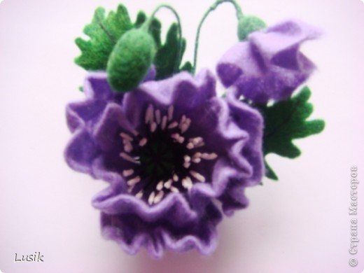 Первые мои валяные цветочки, немного смешные и совсем простенькие. фото 11