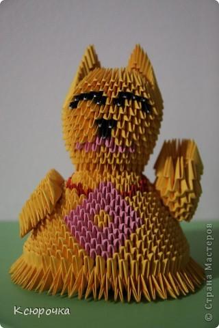Манэки-нэко («Кот счастья» или «Зовущая кошка»)
