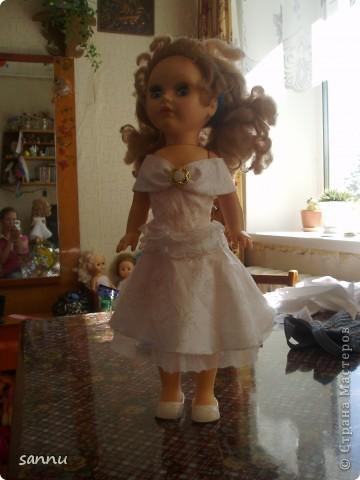 решила сделать платье для куклы из рукава от блузки и вот что получилось фото 2