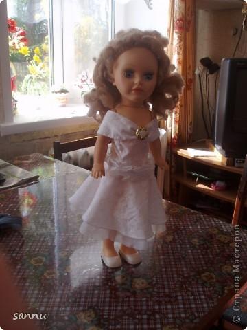 решила сделать платье для куклы из рукава от блузки и вот что получилось фото 4