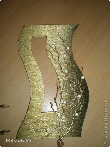 Поделка изделие Моделирование конструирование Настенное украшение Бумага гофрированная фото 1