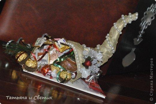 Рог внутри полый и наполнен чаем и конфетами... фото 1