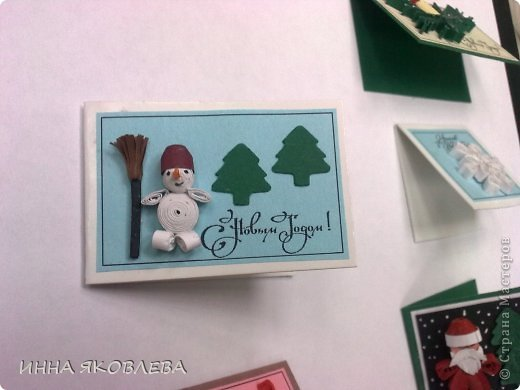 """Эти открыточки мы сделали на городской конкурс """"Рождество в Петербурге"""", номинация : самая маленькая открытка. Для сравнения положила ручку. фото 7"""