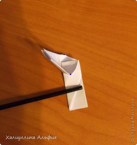 """Эта кусудама очень проста в сборке. Ее я делала по видео-мастерклассу TadashiMori на ютубе. Вот и ссылка: http://www.youtube.com/watch?v=E5pAdiKKsRQ&feature=player_embedded Оригинал https://www.flickr.com/photos/mancinerie/5158402157/in/set-72157625705249454  Мне она немного напомнила всем известную """"Электру"""". Потому что в нее с таким же удовольствием можно """"посадить"""" любые цветочки. А вообще, она сама по себе красива, на мой взгляд. Для сборки совсем не нужен клей. Только бумага, час времени и терпение. фото 16"""