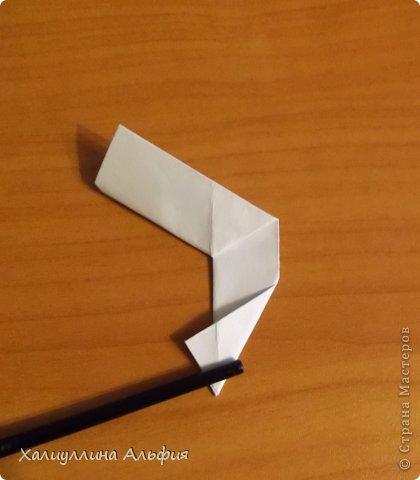 """Эта кусудама очень проста в сборке. Ее я делала по видео-мастерклассу TadashiMori на ютубе. Вот и ссылка: http://www.youtube.com/watch?v=E5pAdiKKsRQ&feature=player_embedded Оригинал https://www.flickr.com/photos/mancinerie/5158402157/in/set-72157625705249454  Мне она немного напомнила всем известную """"Электру"""". Потому что в нее с таким же удовольствием можно """"посадить"""" любые цветочки. А вообще, она сама по себе красива, на мой взгляд. Для сборки совсем не нужен клей. Только бумага, час времени и терпение. фото 22"""