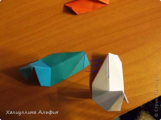 """Эта кусудама очень проста в сборке. Ее я делала по видео-мастерклассу TadashiMori на ютубе. Вот и ссылка: http://www.youtube.com/watch?v=E5pAdiKKsRQ&feature=player_embedded Оригинал https://www.flickr.com/photos/mancinerie/5158402157/in/set-72157625705249454  Мне она немного напомнила всем известную """"Электру"""". Потому что в нее с таким же удовольствием можно """"посадить"""" любые цветочки. А вообще, она сама по себе красива, на мой взгляд. Для сборки совсем не нужен клей. Только бумага, час времени и терпение. фото 24"""