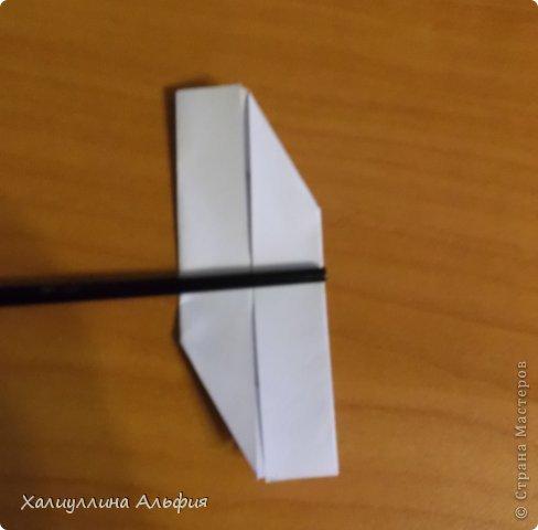 """Эта кусудама очень проста в сборке. Ее я делала по видео-мастерклассу TadashiMori на ютубе. Вот и ссылка: http://www.youtube.com/watch?v=E5pAdiKKsRQ&feature=player_embedded Оригинал https://www.flickr.com/photos/mancinerie/5158402157/in/set-72157625705249454  Мне она немного напомнила всем известную """"Электру"""". Потому что в нее с таким же удовольствием можно """"посадить"""" любые цветочки. А вообще, она сама по себе красива, на мой взгляд. Для сборки совсем не нужен клей. Только бумага, час времени и терпение. фото 8"""