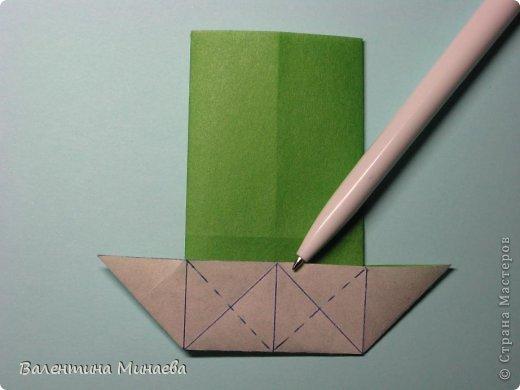 Кусудама Shalimar автор - Валентина Минаева (Valentina Minayeva) модули асимметричные, 60 штук соотношение 3,5 : 4 размер бумаги 5,0 х 6,0 см, итог - 10 см сборка с клеем (в пятерках модулей)  Инна, спасибо за название!  Вот здесь уже есть видео: http://www.youtube.com/watch?v=XCYXM-NuSUU&feature=youtu.be  фото 17