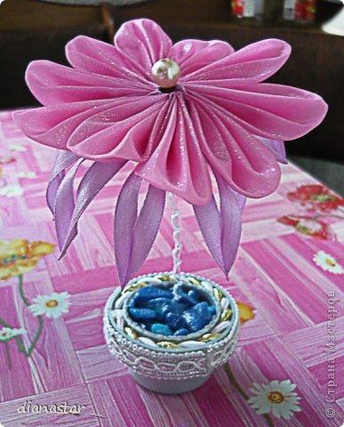 цветок в горшочке